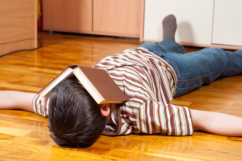 http://www.dreamstime.com/stock-image-teenage-boy-sleeping-book-covering-his-face-image23322671