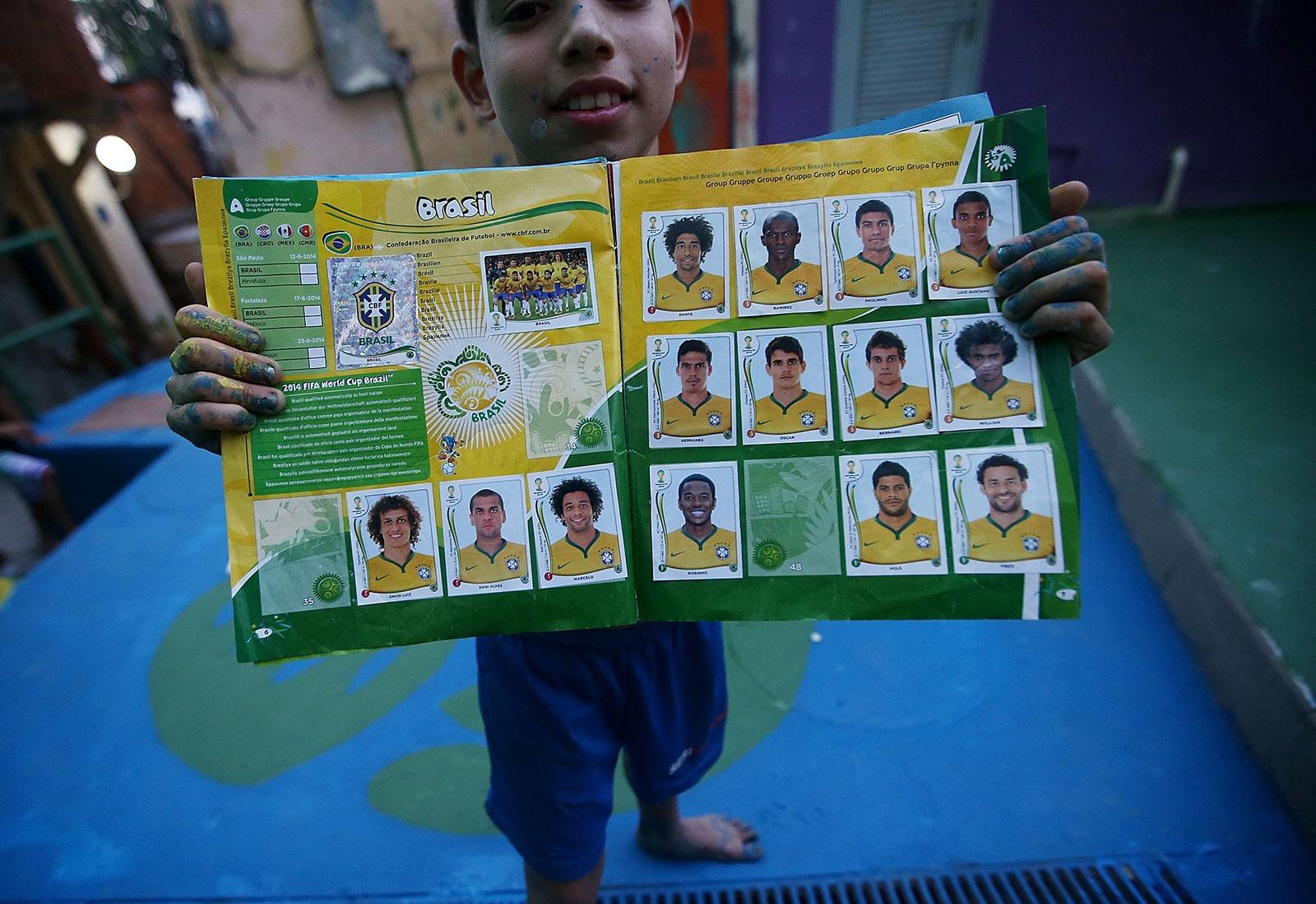 Seleta de legumes hortifruti a boy from santa marta favela with his panini world cup sticker book rio de janeiro brazil 2014 photo by mario tamagetty images fandeluxe Gallery